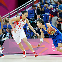 09 August 2012: France Celine Dumerc drives past Russia Natalya Zhedik during 81-64 Team France victory over Team Russia, during the women's basketball semi-finals, at the 02 Arena, in London, Great Britain.