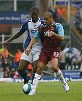 Photo: Steve Bond.<br />Birmingham City v West Ham United. The FA Barclays Premiership. 18/08/2007. Keiron Dyer (R) holds off Olivier kapo (L)