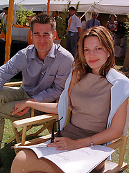 Childrens TV presenter TIM VINCENT and MISS ZOE MANZI, at a polo match in West Sussex on 18th July 1999.MUH 73