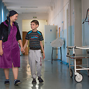 CAPTION: Tatiana has brought Kirill to the hospital from Pallasovka, a small town about 140 miles northeast of Volgograd, near Russia's border with Kazakhstan. LOCATION: Volgograd City Hospital #1, Volgograd, Russia. INDIVIDUAL(S) PHOTOGRAPHED: Tatiana Fedorenko (left) and Kirill Fedorenko (right).