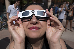 August 21, 2017 - Glendale, California, United States - People look at the partial solar eclipse in Glendale, California on August 21, 2017. During a solar eclipse, the moon passes between the sun and the Earth, appearing to block the sun.(Photo by: Ronen Tivony) (Credit Image: © Ronen Tivony/NurPhoto via ZUMA Press)