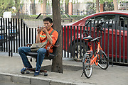 A parking attendant and shared bikes in Beijing<br /><br />Bike sharing in China has multiplied over the years with various brands offering shared bikes which can be unlocked using an application on your mobile telephone, and then locked and left anywhere for the next rider. Ofo and Mobike are the two world leaders. One of the problems is the huge over supply of bikes, which has meant many startups going out of business, and huge bike cemeteries created on the outskirts of China's mega cities, where hundred's of thousands of bikes are rusting away.