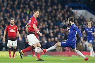 Manchester United Midfielder Nemanja Matic is tackled by Chelsea Forward Gonzalo Higuain on loan from Juventus during the The FA Cup 5th round match between Chelsea and Manchester United at Stamford Bridge, London, England on 18 February 2019.