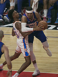 October 19, 2018 - Los Angeles, California, U.S - Tobias Harris #34 of the Los Angeles Clippers tries to get past Terrance Ferguson #23 of the Oklahoma Thunder during their NBA game on Friday October 19, 2018 at the Staples Center in Los Angeles, California. Clippers defeat Thunder, 108-92. (Credit Image: © Prensa Internacional via ZUMA Wire)