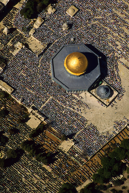 Jerusalem, Israel:  Aerial view of final Friday prayer during Ramadan at the Dome of the Rock and Al Aqsa Mosque.  About 200, 000 people gather for this short prayer.