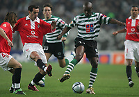 """PORTUGAL - LISBOA 08 JANUARY 2005: PETIT #6 and DOUALA #17 in the 16¼ leg of the Super Liga, season 2004/2005, match  Sporting CP vs SL Benfica (2 - 1), held in """"Alvalade XXI"""" stadium,  08/01/2005  21:57:00<br />(PHOTO BY: NUNO ALEGRIA/AFCD)<br /><br />PORTUGAL OUT, PARTNER COUNTRY ONLY, ARCHIVE OUT, EDITORIAL USE ONLY, CREDIT LINE IS MANDATORY<br /> AFCD-PHOTO AGENCY 2005 © ALL RIGHTS RESERVED"""