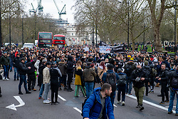 © Licensed to London News Pictures. 20/03/2021. London, UK. A large number of people walk along Park Lane during the anti-lockdown demonstration 'Worldwide Rally For Freedom' held in central London. Photo credit: Peter Manning/LNP