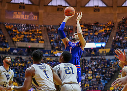 Jan 19, 2019; Morgantown, WV, USA; Kansas Jayhawks forward Dedric Lawson (1) shoots in the lane during the first half against the West Virginia Mountaineers at WVU Coliseum. Mandatory Credit: Ben Queen-USA TODAY Sports