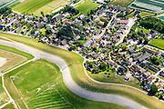 Nederland, Friesland, Gemeente Dongeradeel, 05-08-2014; het tweeling-dorp Paesens-Moddergat, gelegen achter de achter de Waddenzee zeedijk.<br /> Twin-village in the north of the Netehrlands, just behind the seawall of the nearby Wadden Sea.<br /> luchtfoto (toeslag); <br /> aerial photo (additional fee required);<br /> copyright foto/photo Siebe Swart