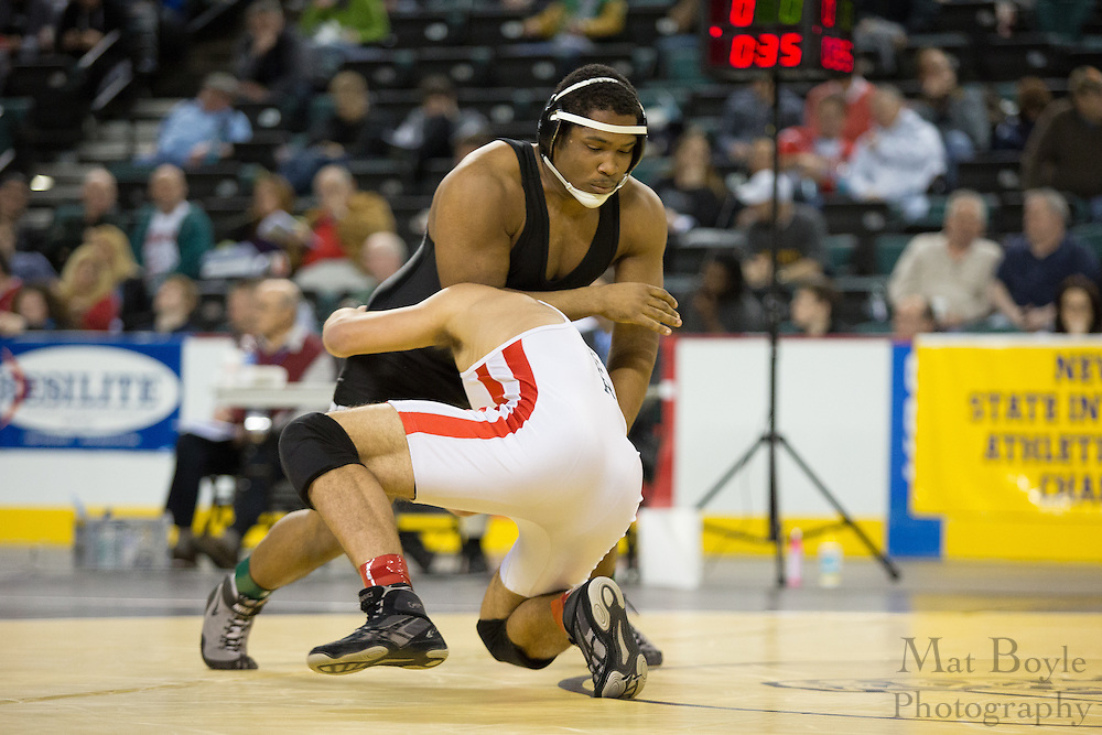 Robbie Maggiulli of Emerson Boro (White and Red) defeats Nigel Toussaint of Egg Harbor in the 220lb 7th place match in the NJ State Wrestling Tournament at Boardwalk Hall in Atlantic CIty, NJ on Sunday March 10, 2013. (photo / Mat Boyle)