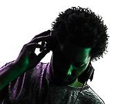 one disc jockey man portrait in silhouette on white background