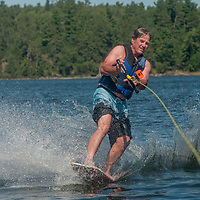 Jay Jensen rides a wake skate on Lake of the Woods, Ontario, Canada.