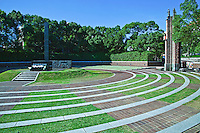 """Ground Zero Hypocenter at Nagasaki Peace Park- commemorating the atomic bombing of the city on August 9, 1945 during World War II.  A plaque at the nearby hypocentre gives the following account and statistics of the damage caused that day. """"At 11:02 A.M., August 9, 1945 an atomic bomb exploded 500 meters above this spot. The black stone monolith marks the hypocenter..The fierce blast wind, heat rays reaching several thousand degrees and deadly radiation generated by the explosion crushed, burned, and killed everything in sight and reduced this entire area to a barren field of rubble..About one-third of Nagasaki City was destroyed and 150,000 people killed or injured and it was said at the time that this area would be devoid of vegetation for 75 years. Now, the hypocenter remains as an international peace park and a symbol of the aspiration for world harmony."""""""