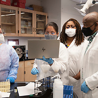 Dr. Irene A. Anyangwe and Dr. Palmer M. Netongo answer questions from students as they run chemical tests on soil samples in a biology lab Friday, April 16 at Navajo Technical University in Crownpoint.
