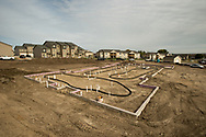 One of many new townhouse foundations is seen in this new development in Williston, N.D., Oct 3, 2013.  Thousands have moved to the area with hopes of landing high paying jobs in the oil field, but the city severely lacks housing to support the influx. The city's current population is estimated to be between 25,000 and 33,000, more than double that of the 2010 U.S. Census Bureau figure of 14,700.