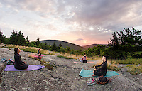 Kresta Turner, Instructor Kate Criscone from Body Design by Joy, Lindsay Bowen and Casey McNutt during sunrise yoga from the top of Piper Mountain on Saturday morning.  (Karen Bobotas/for the Laconia Daily Sun)