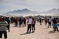 Spectators await arrival of 1st trophy truck at finish of 2011 San Felipe Baja 250