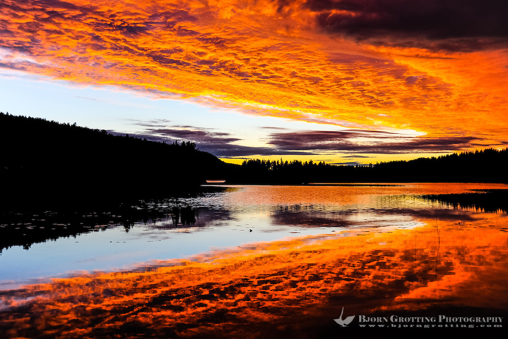 Sweden, Värmland, Sunset. Fire in the sky. Colourful sunset at a small lake in Värmland, not far from the Norwegian border.