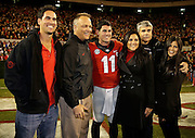 ATHENS, GA - NOVEMBER 23:  Quarterback Aaron Murray #11 of the Georgia Bulldogs poses with his family and Georgia head coach Mark Richt second from left) during Senior Day festivities before the game against the Kentucky Wildcats at Sanford Stadium on November 23, 2013 in Athens, Georgia.  (Photo by Mike Zarrilli/Getty Images)