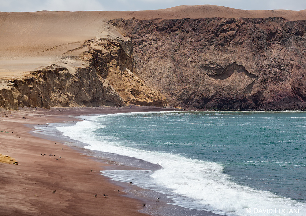 Playa Roja, the famous red sand beach in Paracas National Reserve.