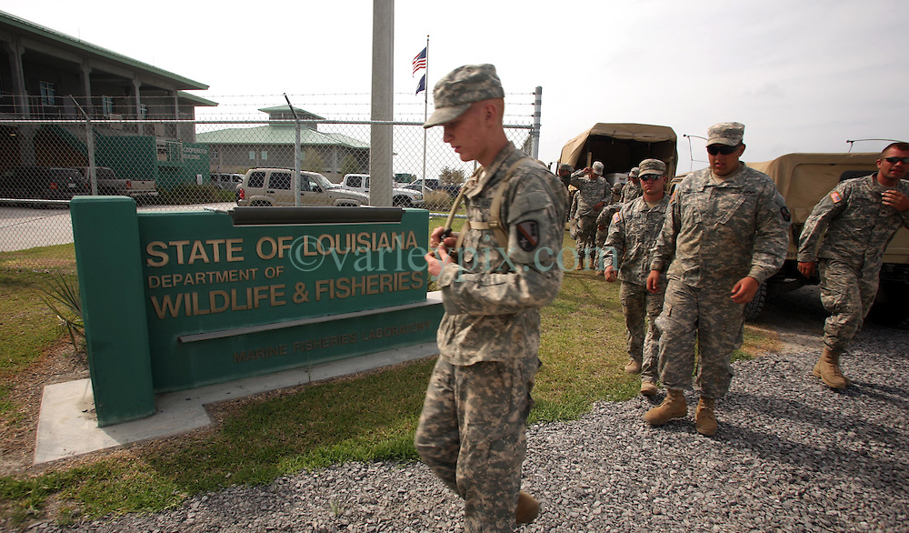 13 May 2010. Grand Isle, Lafourche Parish, Louisiana. <br /> Members of the Louisiana National Guard arrive at the Louisiana Department of Wildlife and fisheries to await furtur instruction as oil lands on the beaches of Jefferson and Lafourche parishes to the west of the Mississippi River outlet. Oil from the Deepwater Horizon catastrophe is evading booms laid out to stop it thanks in part to the dispersants which means the oil travels at every depth of the Gulf. <br /> Photo credit; Charlie Varley/varleypix.com