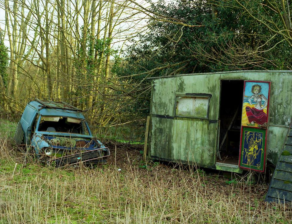 A car/van and a caravan in a field in Dorset. England 2001.