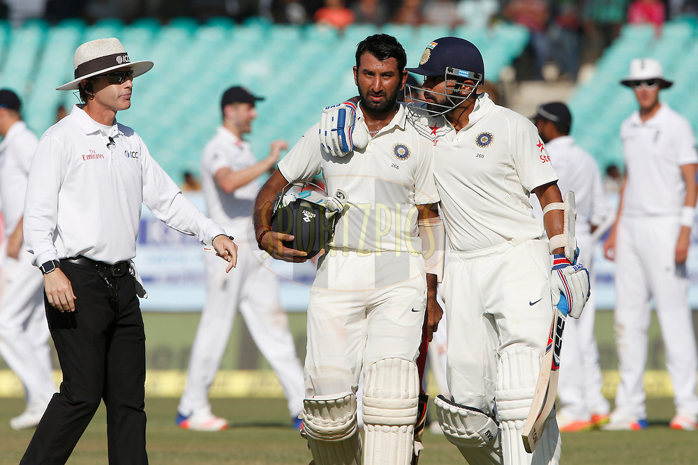 Cheteshwar Pujara of India walk back after his dismissal during day 3 of the first test match between India and England held at the Saurashtra Cricket Association Stadium , Rajkot on the 11th November 2016.<br /> <br /> Photo by: Deepak Malik/ BCCI/ SPORTZPICS
