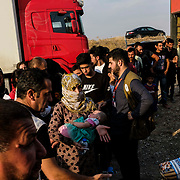 Syrian refugees fleeing the Turkish incursion in Rojava receive bedding materials as they arrive at the Badarash IDPs camp in Dohuk, Iraq onThursday, October 17, 2019. More than 1000 refugees have arrived in Northern Iraq since the beginning of the conflict, with many saying they paid to be smuggled through the Syrian border.