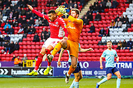 Charlton Athletic midfielder Karlan Ahearne-Grant (18) clashes in the air with Accrington Stanley goalkeeper Jonathan Maxted (1) during the EFL Sky Bet League 1 match between Charlton Athletic and Accrington Stanley at The Valley, London, England on 19 January 2019.