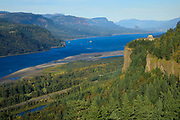 A barge passes beneath Vista House in the Columbia Gorge, Oregon.