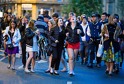 © Licensed to London News Pictures. 01/05/2017. Oxford, UK. Oxford University students and members of the public make their way to Magdalen Bridge in Oxford to celebrate May Day in the early hours of the morning. Students were again prevented from jumping from the bridge in tot he water, which has historically been a tradition, due to injuries at a previous years event . Photo credit: Ben Cawthra/LNP