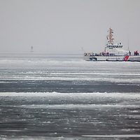 The US Coast Guard  87' Coastal Patrol Boat Sailfish based out of Coast Guard Station Sandy Hook doing maneuvers in Sandy Hook Bay severely iced over during the winter.