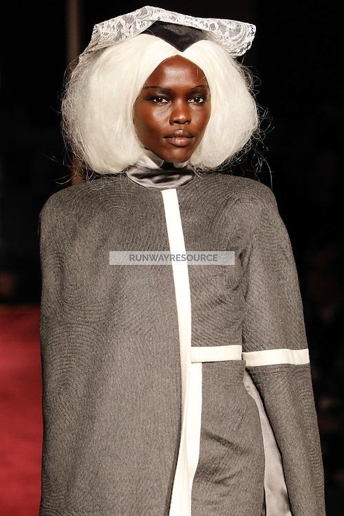 Adau Mornyang walks the runway wearing Thom Browne Fall 2014 Collection, <br /> Thom Browne (Designer)<br /> Jimmy Paul (Hair Stylist)<br /> Sil Bruinsma (Makeup Artist)<br /> Edward Kim (Casting Director)<br /> Julie Kandalec (Manicurist)