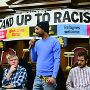 Speaker Christopher currently facing deportation at the  Stand Up To Racism  hosts Challenging the hostile environment and racism will democracy breaking its own law with Jeremy Corbyn labelling Brexit European  stealing job, Migrant rapist, Muslim terrorists, Muslim Grooming, African/Black is a criminal or rapist, Chinese the #coronavirus and let the refugees drown at Islington Town Hall on 6 March 2020, London, UK.