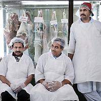 Abu Dhabi, United Arab Emirates 06 April 2009.Butchers in a market of Abu Dhabi.PHOTO: EZEQUIEL SCAGNETTI