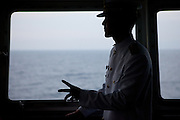 """Captain Jin-Won Kim on the captains bridge of the """"Eastern Dream"""" ferry connecting Donghae in South Korea with Vladivostok in Russia. Donghae, South Korea, Republic of Korea, KOR, 11.01.2010."""