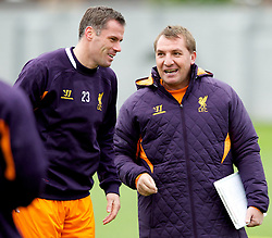 LIVERPOOL, ENGLAND - Wednesday, November 7, 2012: Liverpool's manager Brendan Rodgers talks to Jamie Carragher during a training session at the club's Melwood Training Ground ahead of the UEFA Europa League Group A match against FC Anji Makhachkala. (Pic by Vegard Grott/Propaganda)