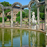 View of the curved north end of the monumental mystical Canopus. Villa Adriana. Tivoli. Italy. The Canopus is a reflecting pool 228 metres long and lined and surrounded by columns and statues.