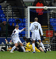 Photo: Paul Greenwood.<br />Bolton Wanderers v Arsenal. The FA Cup. 14/02/2007. Bolton's Stelios, left, beats Arsenal's Abou Diaby and Manuel Almunia only to see his shot hit the bar