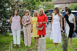 Brigitte Macron, wife of French President Emmanuel Macron, U.S. First Lady Melania Trump , Akie Abe, wife of Japan's Prime Minister Shinzo Abe, Chile's First Lady Cecilia Morel, Jenny Morrison, wife of Australia's Prime Minister Scott Morrison, Malgorzata Tusk, wife of European Council President Donald Tusk pose in a field of Espelette pepper during a visit on traditional Basque culture in Espelette, near Biarritz as part of the G7 summit.August 25, 2019. Photo by Thibaud Moritz/ABACAPRESS.COM