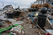 Graves damaged by the tsunami in the ruined landscapes of Shimo Masuda, near Sendai airport. Residents had 30 minutes to flee the tsunami after a magnitude 9 earthquake struck off the coast on March 11th leveling the town killing large numbers of people. Shimo Masuda, Sendai, Miyagi, Japan. Wednesday May 4th 2011