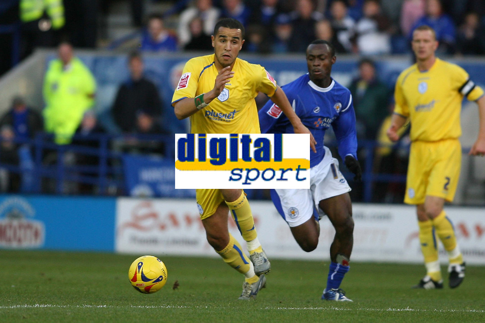 Photo: Pete Lorence.<br />Leicester City v Sheffield Wednesday. Coca Cola Championship. 02/12/2006.<br />Madjid Bougherra and Elvis Hammond battle for the ball.
