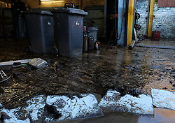 © Licensed to London News Pictures. 29/12/15<br /> York, UK. <br /> <br /> Spill pads are used to absorb oil at a flooded motor engineering business as flood water begins to subside on Huntington Road in York. Further rainfall is expected over coming days as Storm Frank approaches the east coast of the country.<br /> <br /> Photo credit : Ian Forsyth/LNP