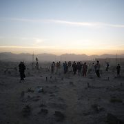 November 08, 2012 - Kabul, Afghanistan: Children play in a cemetery at sunset in the outskirts of Kabul. (Paulo Nunes dos Santos)