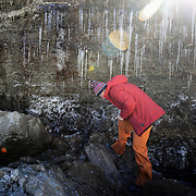 Glaciologist Andrea Fischer from the Austrian Institute for Interdisciplinary Mountain Research, inspects a bog at 2280 masl. where she discovered a tree trunk in 2017 at Stubaier glacier ski resort near Neustift im Stubaital, Austria, October 22, 2018. The bog was covered by Schaufelferner glacier around 12,000 years ago. REUTERS/Lisi Niesner