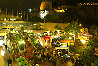 23/11/2004 - UEFA Champions League - Group A - AS Monaco v Liverpool  - Stade Louis II, Monte Carlo<br />A lone Liverpool flag hangs amongst the bars and palm trees in Monte Carlo below the Royal Palace as Liverpool fans congregate before the match.<br />Photo:Jed Leicester/Back Page Images