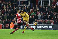 Football - 2016 / 2017 Premier League - Southampton vs. Tottenham Hotspur<br /> <br /> Dele Alli of Tottenham Hotspur curls the ball past Southampton's Ryan Bertrand to score Tottenhams fourth at St Mary's Stadium Southampton England<br /> <br /> COLORSPORT/SHAUN BOGGUST