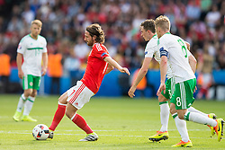 PARIS, FRANCE - Saturday, June 25, 2016: Wales'  Joe Allen in action against Northern Ireland's Corry Evans and Steven Davis during the Round of 16 UEFA Euro 2016 Championship match at the Parc des Princes. (Pic by Paul Greenwood/Propaganda)