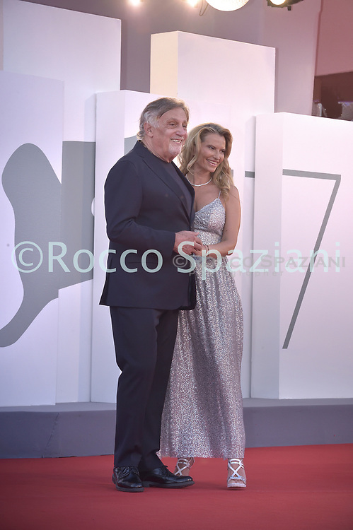 """VENICE, ITALY - SEPTEMBER 10:  Andrea Roncato ,  Nicole Moscariello walks the red carpet ahead of the movie """"Nuevo Orden"""" (New Order) at the 77th Venice Film Festival on September 10, 2020 in Venice, Italy.<br /> (Photo by Rocco Spaziani)"""