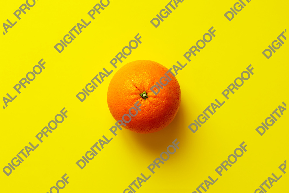 Fresh orange fruit isolated on yellow background viewed from above, flatlay style.  Close-up.